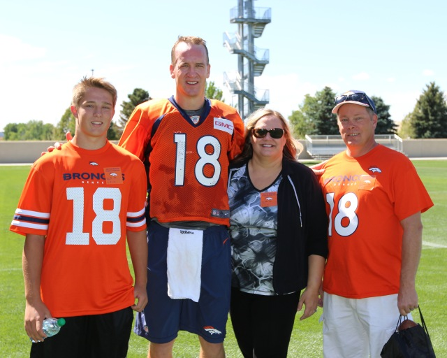 My son Nick, Peyton Manning, me, and my hubby Randy Sept 1, 2015 at the Broncos Practice